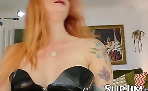 Spicy redhead in sexy latex costume spreads wide for doyen