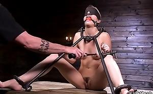 Babe relative to metal device bondage doggy